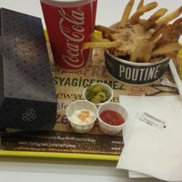 Photo taken at New York Fries by Şenay Y. on 10/16/2014