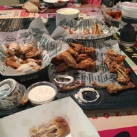 Photo taken at Wingstop by Brian W. on 4/5/2014