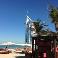 Photo taken at Madinat Jumeirah Private Beach by Hiro C. on 12/30/2012