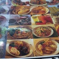 Photo taken at Mega Kitchen by Bryxton O. on 12/3/2012