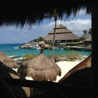 Photo taken at Playa Xcaret by Cristian A. on 3/18/2013