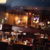 Photo taken at Compari's On the Park by Vivi on 6/7/2014