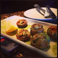 Photo taken at BJ's Restaurant & Brewhouse by Gabriela W. on 8/6/2013