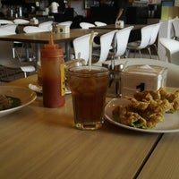 Photo taken at Qua-Li Noodle & Rice by Tomy A. on 1/16/2014