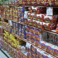 Photo taken at Top 100 Supermarket by John D. on 3/25/2013