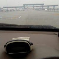 Photo taken at Plaza Tol Saujana Putra by Md Nordin on 3/13/2014