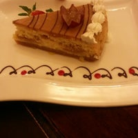 Photo taken at Creme Brulee Chocolaterie by cindy v. on 2/26/2014
