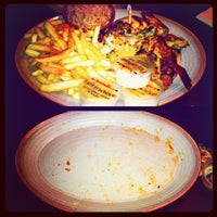 Photo taken at Nando's by Jay S. on 12/28/2012