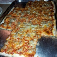 Photo taken at Pirrone's Pizzeria by Ian H. on 12/18/2012