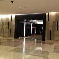 Photo taken at New World Makati Hotel by Riza M. on 2/20/2013