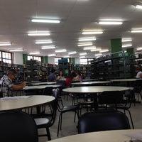 Photo taken at Biblioteca PUC Minas by Leela V. on 11/20/2012