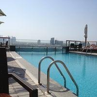 Photo taken at Hilton Dubai Roof Pool by Larissa V. on 11/4/2013