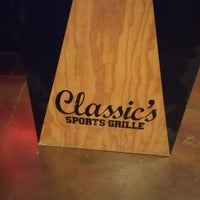 Photo taken at Classic's Sports Grille by Teddy B. on 1/1/2015