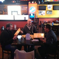 Photo taken at Classic's Sports Grille by Teddy B. on 2/17/2013