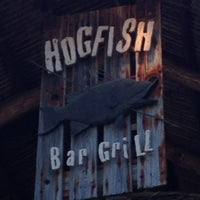 Photo taken at Hogfish Bar & Grill by Peter L. on 3/23/2013