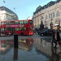 Photo taken at Piccadilly Circus by Favio A. on 5/11/2013