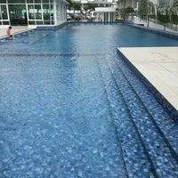 Photo taken at Casa Tropika Swimming Pool by Nicole L. on 9/27/2014
