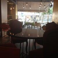 Photo taken at Le Café by Mia L. on 5/8/2013