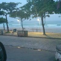 Photo taken at Praia Grande by Fabio F. on 2/13/2013