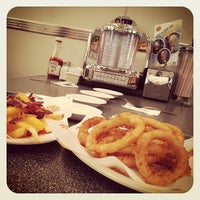 Photo taken at Johnny Rockets by Mohd Shah Redza H. on 2/15/2013