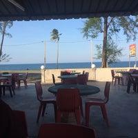 Photo taken at Pantai Teluk Lipat by Jaie A. on 6/30/2017