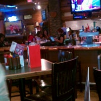 Photo taken at Smokey Bones Bar & Fire Grill by Steep J. on 11/24/2012