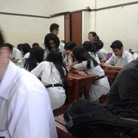 Photo taken at SMA St. Thomas 1 Medan by Kinton A. on 1/13/2014