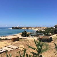Photo taken at Praia de Vila Nova de Milfontes by Zach S. on 7/6/2017