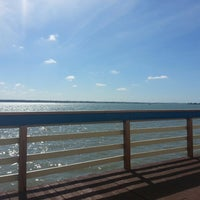 Photo taken at Boardwalk Behind Shoppes Of Sand Key by Zach S. on 2/22/2013