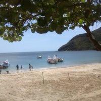 Photo taken at Playa La Galera by Cesar P. on 7/8/2013