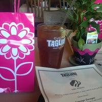 Photo taken at Cucina Tagliani by Stephanie R. on 5/19/2013