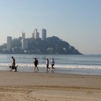 Photo taken at Praia do Gonzaguinha by Mauricio V. on 4/28/2013