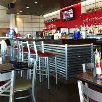 Photo taken at Delta Charlie's Bar & Grill by Kagan B. on 1/20/2012