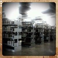 Photo taken at Biblioteca Central Prof. Alpheu da Veiga Jardim (BC) by Jaqueline N. on 1/26/2012