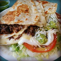 Photo taken at Taqueria Carniceria Tapatia by Alina Lee S. on 10/17/2014