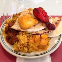 Photo taken at Minerva Indian Cuisine by M C. on 1/9/2014