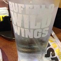 Photo taken at Buffalo Wild Wings by Melanie Q. on 12/13/2013