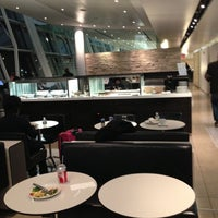 Photo taken at Swiss Lounge by Kazuki K. on 12/15/2012