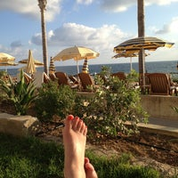 Photo taken at Serenity Pool, Alexander The Great Hotel by Nessie R. on 9/16/2013