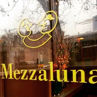 Photo taken at Pizza Mezzaluna by Erika M. on 12/24/2014