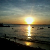 Photo taken at Praia do Porto da Barra by Misael F. on 12/16/2012