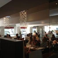 Photo taken at Max Azria Café by Denis on 9/4/2013
