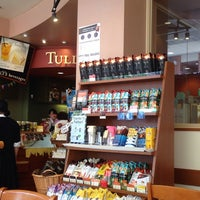 Photo taken at Tully's Coffee by 市川 勇. on 5/24/2014