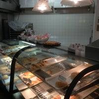 Photo taken at Vie De France Bakery & Cafe by Edward V. on 12/22/2012