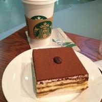 Photo taken at Starbucks by myrtle m. on 1/20/2013