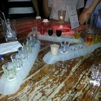 Photo taken at Revolution Bar and Restaurant by Vanessa R. on 1/22/2013