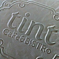 Photo taken at Tint Cafe & Bistro by Müge A. on 4/11/2013