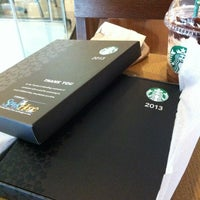 Photo taken at Starbucks Coffee by Roman Jay R. on 1/1/2013