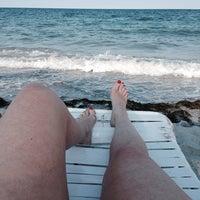 Photo taken at Ritz Carlton Key Biscayne white sand beach by Laura L. on 4/25/2014