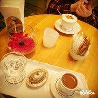 Photo taken at Muizz Cafe & Restaurant by Ezgi K. on 12/27/2015